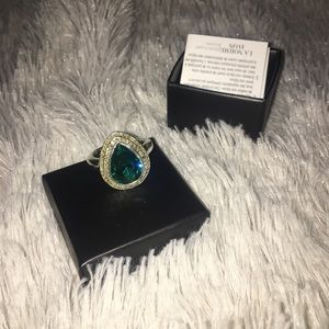 New in the box emerald ring